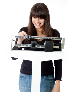 weight-loss-happy-woman-scale.jpg